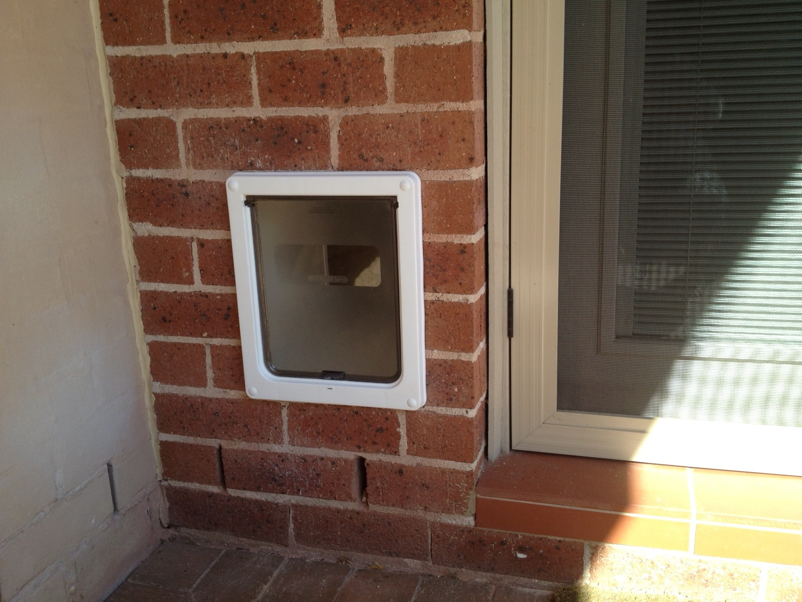Optional customised tunnel - Interior door with pet door installed ...